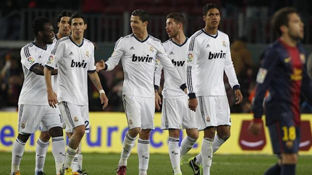 Real Madrid's Cristiano Ronaldo (C) reacts as he leaves the pitch with team mates after their Spanish King's Cup semifinal second round soccer match against Barcelona (Reuters)
