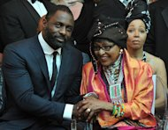 "Nelson Mandela's second wife Winnie Madikizela–Mandela (R) and British actor Idris Elba, who plays the role of Nelson Mandela in the movie ""Mandela, Long Walk to Freedom"", attend the movie's premiere in Johannesburg on November 3, 2013"