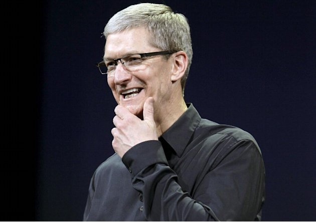 FILE- In this Wednesday, March 7, 2012, file photo, Apple CEO Tim Cook announces a new iPad during an Apple announcement in San Francisco. Apple CEO Tim Cook is expected to show off new iPhone softwar