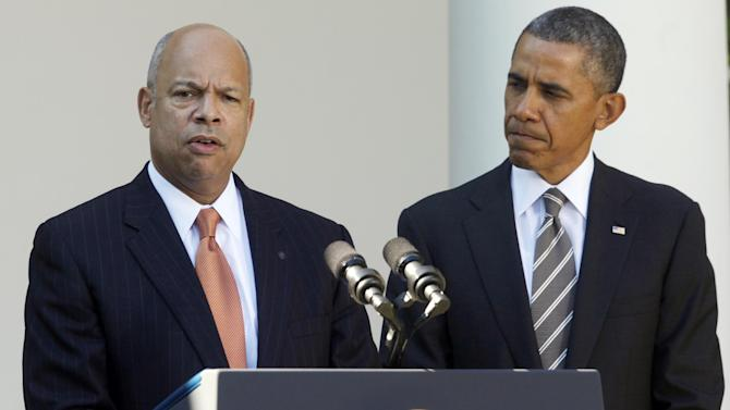President Barack Obama stands with Jeh Johnson, his choice for the next Homeland Security Secretary, in the Rose Garden at the White House in Washington, Friday, Oct. 18, 2013. Johnson was general counsel at the Defense Department during the wars in Iraq and Afghanistan. (AP Photo/Charles Dharapak)