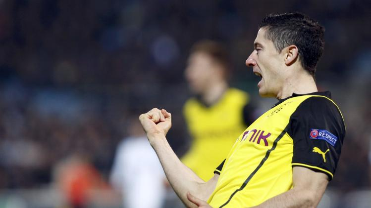 Borussia Dortmund's Lewandowski celebrates after scoring the first goal against Olympique Marseille during their Champions League soccer match in Marseille