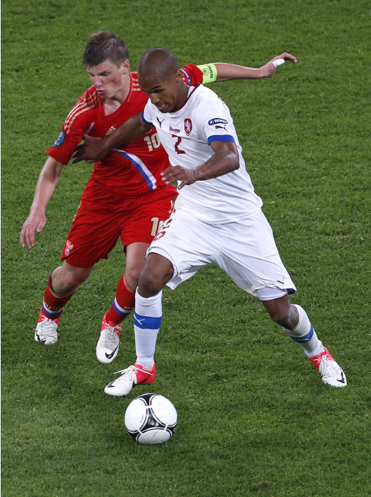Russia's Andrei Arshavin, left, and Czech Republic's Theodor Gebre Selassie vie for the ball during the Euro 2012, Group A soccer match between Russia and Czech Republic, in Wroclaw, Poland, Friday, J