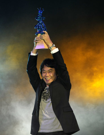 "Shigeru Miyamoto accepts the video game hall of fame award for ""The Legend of Zelda"" onstage at Spike TV's Video Game Awards on Saturday, Dec. 10, 2011, in Culver City, Calif. (AP Photo/Chris Pizzello)"