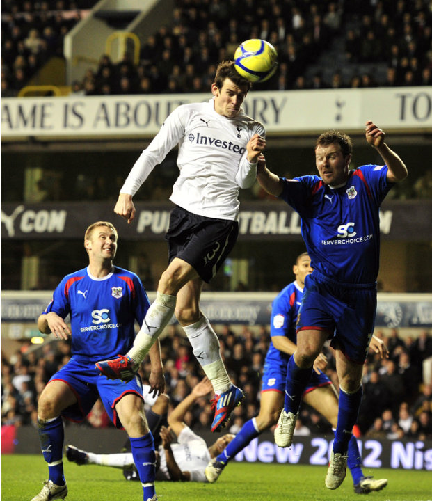 Tottenham Hotspur's Welsh Defender Gareth Bale Heads The Ball Towards The Goal   RESTRICTED TO EDITORIAL USE. No Use AFP/Getty Images