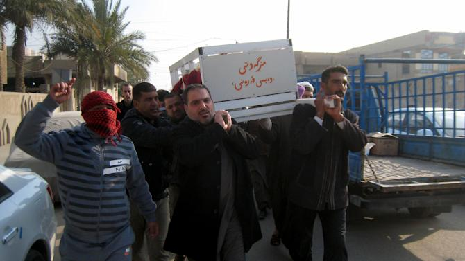 In this Thursday, Jan. 23, 2014 photo, mourners carry the coffin of Haitham Abdo Rahman, 38, who was killed in a bombing, before his burial at the cemetery in Fallujah, Iraq. Islamic militants controlling a mainly Sunni area west of Baghdad are so well-armed that they could occupy the capital, members of Iraq's al-Qaida branch - known as the Islamic State of Iraq and the Levant - have taken over parts of Ramadi, the capital of the largely Sunni western province of Anbar. (AP Photo)