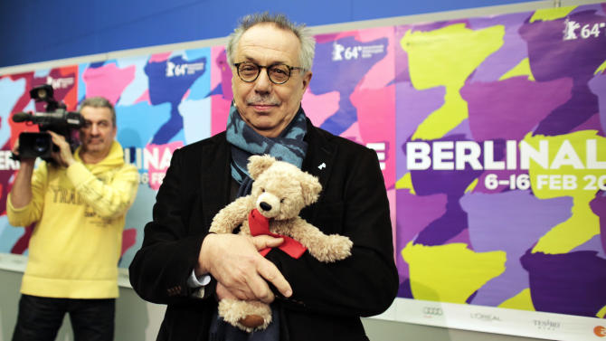Dieter Kosslick director of the International Film Festival Berlin, Berlinale, poses with a Berlinale bear for media prior to the annual program press conference in Berlin, Tuesday, Jan. 28, 2014. The 64. Berlinale will take place in the German capital from Thursday, Feb. 6, until Sunday, Feb. 16, 2014. (AP Photo/Markus Schreiber)