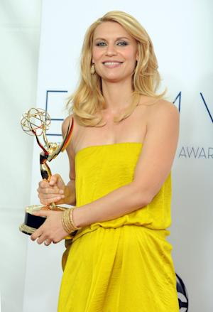 "Actress Claire Danes, winner of the award Outstanding Lead Actress In A Drama Series award for ""Homeland,"" poses backstage at the 64th Primetime Emmy Awards at the Nokia Theatre on Sunday, Sept. 23, 2012, in Los Angeles. (Photo by Jordan Strauss/Invision/AP)"