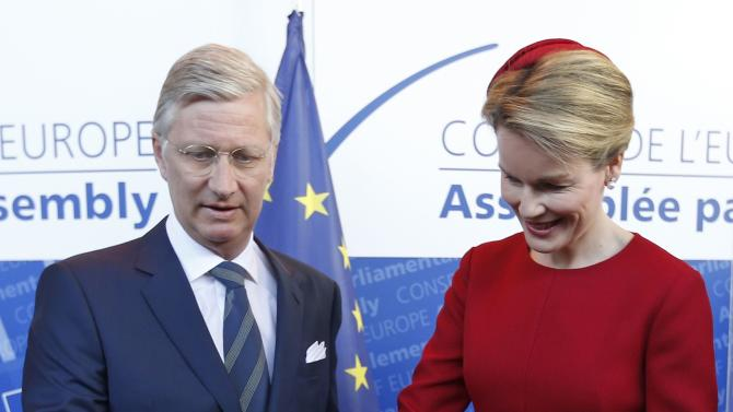 Belgium's King Philippe and Queen Mathilde sign a guest book as they arrive at the Council of Europe ahead of King Philippe's address to the Pariamentary Assembly of the institution in Strasbourg