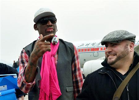 Former NBA basketball star Dennis Rodman arrives at Pyongyang airport in Pyongyang