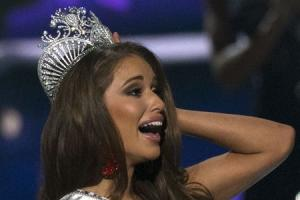 Miss Nevada Nia Sanchez reacts after winning the 2014 Miss USA beauty pageant in Baton Rouge, Louisiana