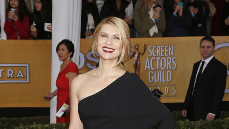 Claire Danes arrives at the 19th Annual Screen Actors Guild Awards at the Shrine Auditorium in Los Angeles on Sunday Jan. 27, 2013. (Photo by Todd Williamson/Invision for The Hollywood Reporter/AP Images)