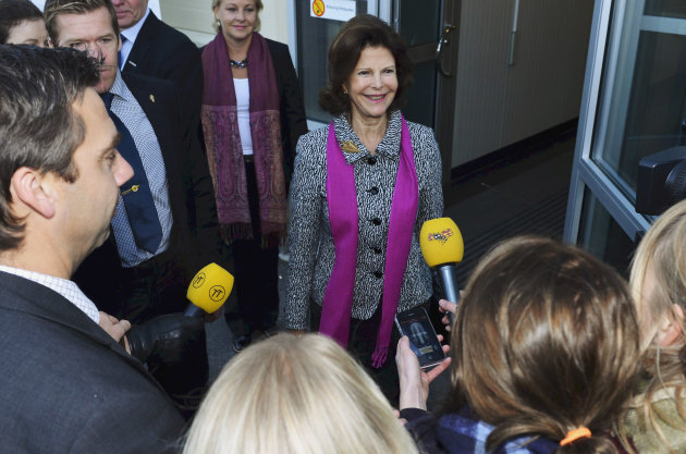 Queen Silva of Sweden, center, arrives at Samhall in Jordbro outside Stockholm, Thursday Oct. 25, 2012 where she confirmed the engagement of her daughter Princess Madeleine. Madeleine and her U.S.-British boyfriend Christopher O'Neill announced their engagement on the royal palace website on Thursday. The 30-year-old Madeleine is the youngest of King Carl XVI Gustaf and Queen Silvia's three children and is fourth in line to the throne. The tabloid Expressen reported early Thursday that O'Neill, a 38-year-old financier she met in New York, had proposed to the princess, and the couple confirmed the news in a brief video clip posted on the royal website. (AP Photo/ Claudio Bresciani) SWEDEN OUT
