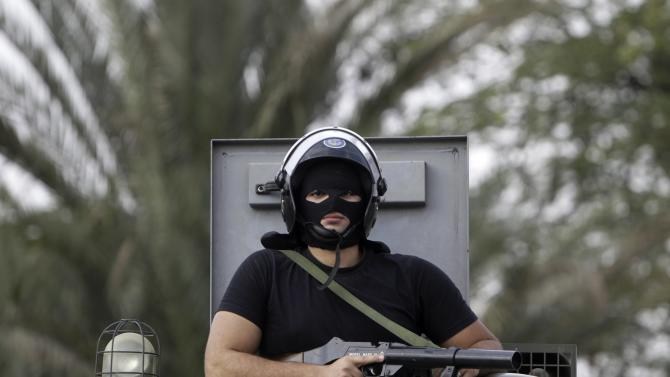 A riot police maintains order on al-Azhar university campus during student protests in Cairo