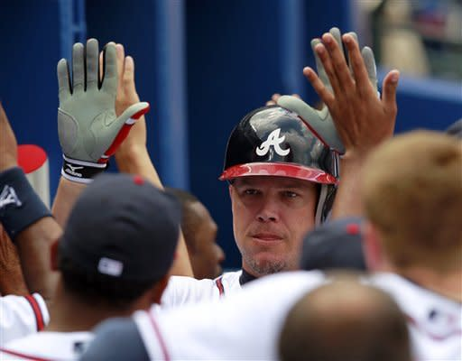 Jones' 3-run HR powers Braves past Brewers, 7-4