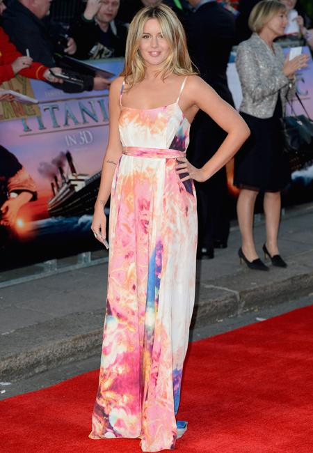 Celebrity fashion: Made In Chelsea's Caggie Dunlop wore a painted maxi dress to the Titanic 3D premiere but failed to maximize her fashion potential. It was more fitting for the beach then the red car