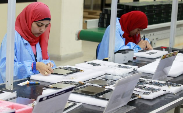"Workers are seen during the manufacturing process for Egypt's first tablet computer ""Inar"" at a factory in Benha"