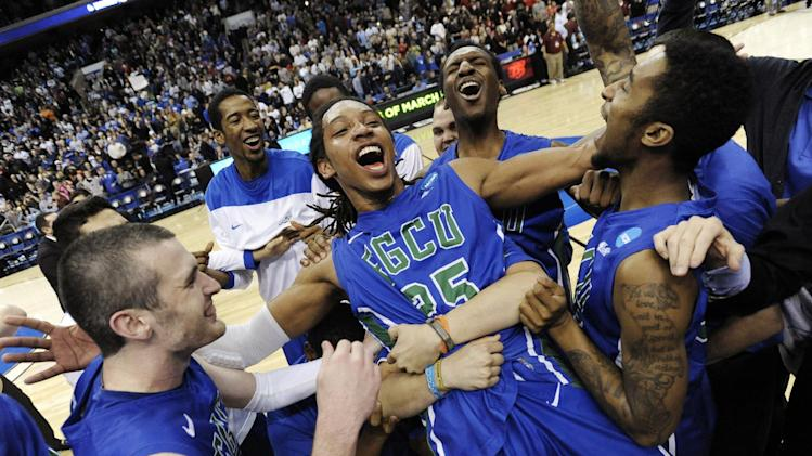 FILE - In this March 24, 2013, file photo, Florida Gulf Coast's Sherwood Brown, center, celebrates with teammates after their 81-71 win over San Diego State in a third-round game in the NCAA college basketball tournament in Philadelphia. Florida Gulf Coast became the first No. 15 seed to make the Sweet 16. (AP Photo/Michael Perez, File)