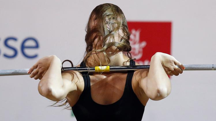Marie-Julie Malboeuf of Canada lifts during the women's 58kg weightlifting competition at the 2014 Commonwealth Games in Glasgow