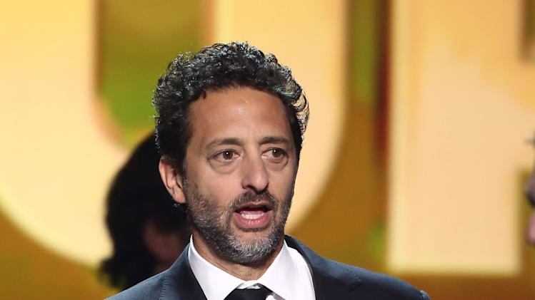 "Grant Heslov accepts the award for best picture for ""Argo"" at the 18th Annual Critics' Choice Movie Awards at the Barker Hangar on Thursday, Jan. 10, 2013, in Santa Monica, Calif.  (Photo by Matt Sayles/Invision/AP)"