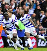 Queens Park Rangers' Djibril Cisse (R) celebrates scoring a goal during their English Premier League match against Stoke City at Loftus Road in London, on May 6. QPR play Manchester City next, at Etihad Stadium, on Sunday