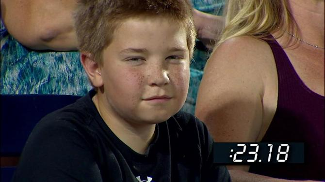 Young baseball fan gives ESPN camera epic stare