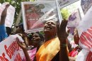 """A mother from the """"Dead and Missing Person's Parents Front"""" organization cries during a protest against U.N. High Commissioner for Human Rights Pillay's visit in front of the U.N. headquarters in Colombo"""