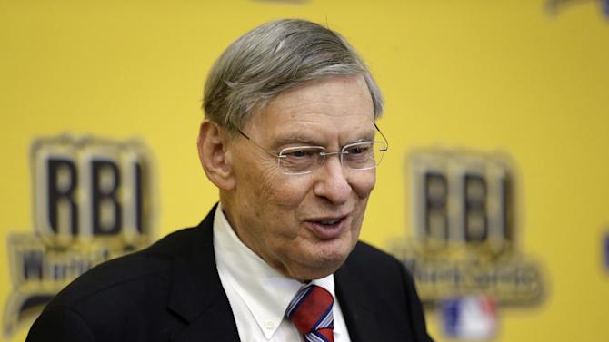 """Baseball Commissioner Allan H. """"Bud"""" Selig smiles as he responds to a question from reporters after addressing participants of the 2014 Reviving Baseball in Inner Cities World Series during a luncheon, Wednesday, Aug. 6, 2014, in Grapevine, Texas. Selig is retiring in January. (AP Photo/Tony Gutierrez)"""