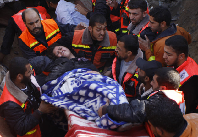 A member of the Abdel Aal family is rescued after his family house collapsed during an Israeli forces strike in the Tufah neighborhood, Gaza City, Sunday, Nov. 18, 2012. The Israeli military widened i