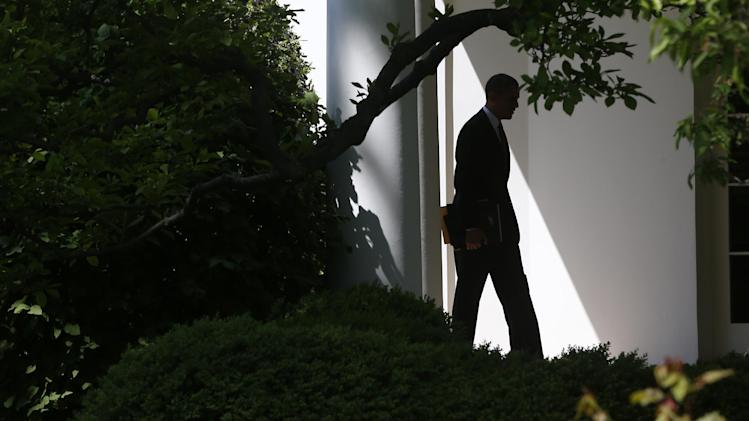 President Barack Obama walks back to the Oval Office of the White House in Washington, Friday, April 26, 2103, upon his returned from speaking at the 2013 Planned Parenthood National Conference in Washington, Friday, April 26, 2013. (AP Photo/Charles Dharapak)