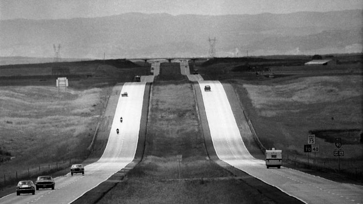 FILE - In this Sept. 8, 1972 file photo, cars pass by on Interstate 90, into the Black Hills in Murdo, S.D. After rising continuously since World War II, driving by American households has declined nearly 10 percent since 2004. (AP Photo/File)