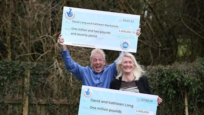 David and Kathleen Long pose for a photograph with their symbolic cheques from the British lottery at The Mallard in Scunthorpe, England. David and Kathleen Long won the prize in the EuroMillions Mega Friday Draw, having already scooped up 1 million pounds $1.5 million) in 2013. The couple also won a luxury car. Lottery operator Camelot said Wednesday the couple beat odds of 283-billion-to-1. (AP Photo/PA, Lynne Cameron) UNITED KINGDOM OUT, NO SALES, NO ARCHIVE