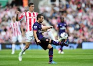 "Arsenal's Santi Cazorla (R) and Stoke City's Geoff Cameron during their Premier League match on August 26. ""One month ago Cazorla and (Lukas) Podolski did not know each other. There is work to be done on the training ground. There is potential but something is missing, "" manager Arsene Wenger said of their goalless draw"