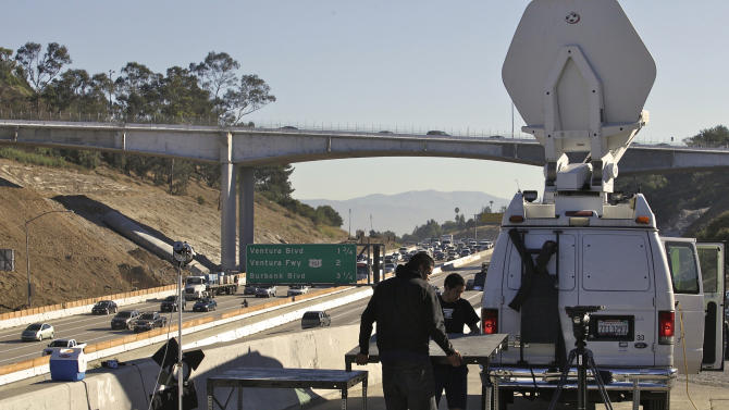 "Traffic moves along the Interstate 405 freeway Monday, July, 18, 2011, in Los Angeles. A major Los Angeles freeway construction shutdown and breathless warnings of ""Carmageddon"" gridlock were in the rearview mirror Monday morning for motorists heading into the four-hour commuter rush. (AP Photo Damian Dovarganes)"