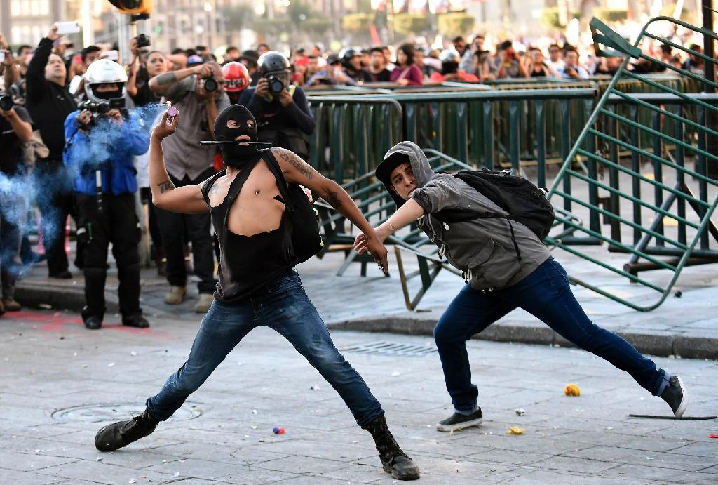 Clashes after Mexico City massacre protest