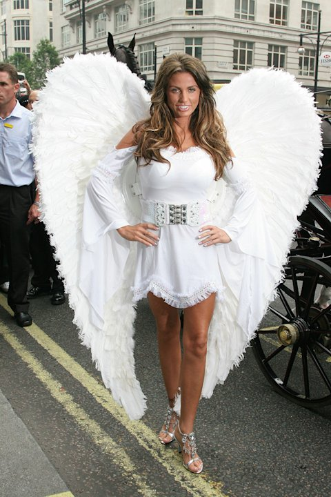 Katie's next book was called 'Angel' so it seemed only fitting to launch it dressed as one. She plumped for a white dress and huge wings and was taken to the location in a horse-drawn carr