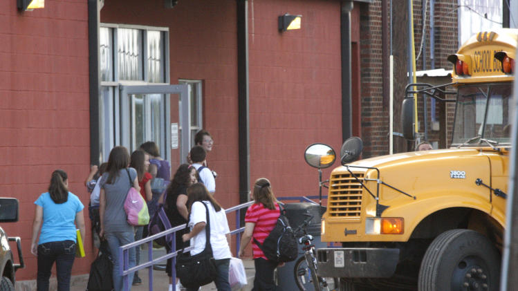 In this Aug. 25, 2008 photo, students arrive for the first day of classes at the Harrold Independent School District in Harrold, Texas.  The school has a policy allowing teachers and other employees to carry concealed weapons on campus. Some lawmakers in at least five other states are looking into similar legislation in the wake of last week's deadly elementary school shooting in Newton, Conn. Anti-gun groups oppose the measure. (AP Photo/The Fort Worth Star-Telegram, Ron T. Ennis)  MAGS OUT; (FORT WORTH WEEKLY, 360 WEST); INTERNET OUT