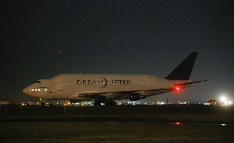 A Boeing 747 LCF Dreamlifter sits on the runway after accidentally landing at Col. James Jabara Airport in Wichita, Kan. Wednesday night Nov. 20, 2013. Boeing says the Dreamlifter landed safely at Jabara, about eight miles from McConnell Air Force Base in Wichita where it was supposed to land. (AP Photo/Wichita Eagle, Jaime Green)
