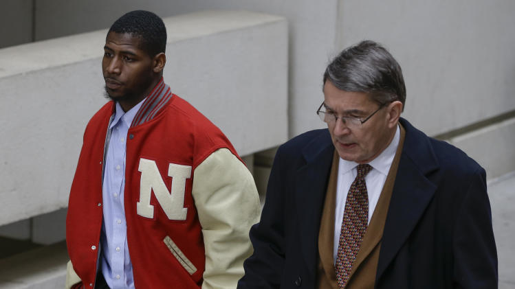 New England Patriots cornerback Alfonzo Dennard, left, and his attorney Terry Dougherty walk outside the Lancaster County courthouse in Lincoln, Neb., Thursday, April 11, 2013 after Dennard was sentenced to two years probation, 100 hours of community service and 30 days in jail starting March 1, 2014. Dennard was found guilty of assaulting a police officer and resisting arrest in an incident in Lincoln, Neb. last year. (AP Photo/Nati Harnik)