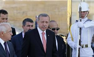 Turkish Prime Minister Erdogan attends a ceremony marking the 91st anniversary of Victory Day at the mausoleum of Mustafa Kemal Ataturk, founder of modern Turkey, in Ankara