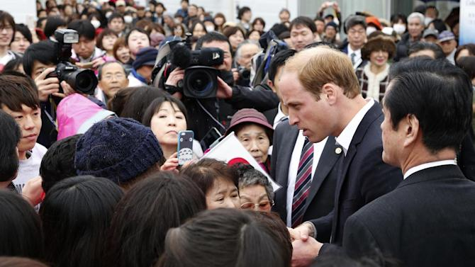 Britain's Prince William chats with local people as he visits Chime of Hope shopping center in a neighborhood destroyed by the March 11, 2011 earthquake and tsunami, in Onagawa, Miyagi Prefecture, in northeastern Japan, Sunday, March 1, 2015. (AP Photo/Shizuo Kambayashi)