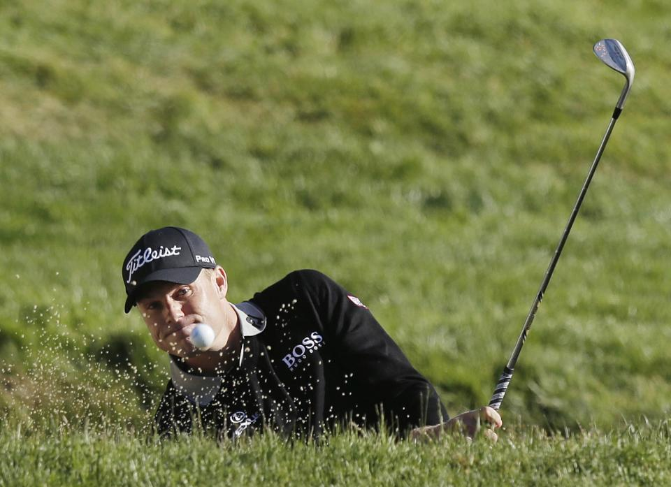 Nick Watney hits out of a bunker on the second hole during the second round of the U.S. Open Championship golf tournament Friday, June 15, 2012, at The Olympic Club in San Francisco. (AP Photo/Charlie Riedel)