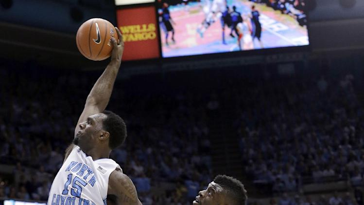 North Carolina's P.J. Hairston (15) drives to the basket with Reggie Bullock (35) against Duke's Seth Curry (30) during the first half of an NCAA college basketball game in Chapel Hill, N.C., Saturday, March 9, 2013. (AP Photo/Gerry Broome)