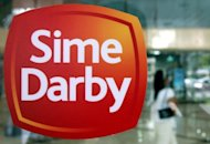 The former head of Malaysian plantation giant Sime Darby appeared in court Tuesday over a land deal that saddled the state-controlled firm with $30 million in losses, a prosecutor said