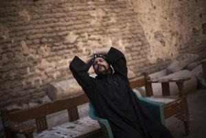 In this Sept. 30, 2013 photo, Father Shenouda rests …