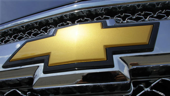 "FILE - In this July 8, 2012 file photo, the Chevrolet logo shines on a Silverado pickup truck at an auto dealership in Springfield, Ill. Ever since the company left bankruptcy three years ago, General Motors' ads haven't boosted sales much. The company's biggest campaign, ""Chevy Runs Deep,"" has failed to generate buzz. And now, GM has forced out its star marketing chief just as it's about to launch two key vehicles. (AP Photo/Seth Perlman, File)"