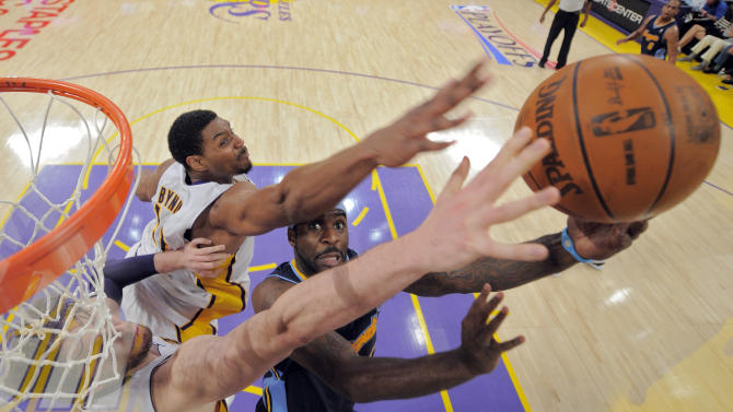 Denver Nuggets point guard Ty Lawson, right, puts up a shot as Los Angeles Lakers center Andrew Bynum, upper left, and power forward Pau Gasol of Spain defend during the first half of an NBA first-round playoff basketball game, Sunday, April 29, 2012, in Los Angeles. (AP Photo/Mark J. Terrill)