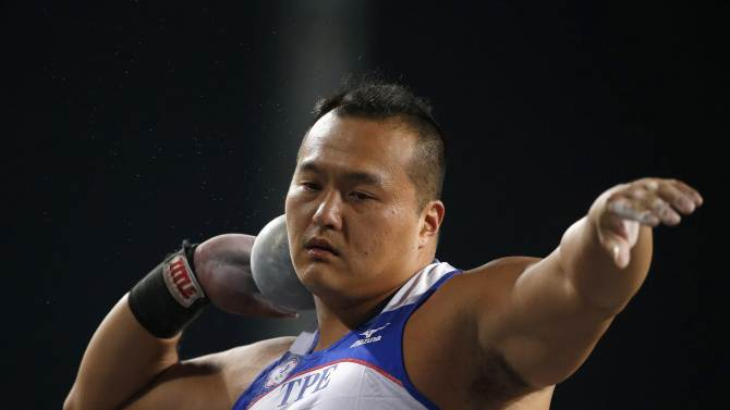 Taiwan's Chang Ming Huang competes in the men's shot put final at the Incheon Asiad Main Stadium during the 17th Asian Games