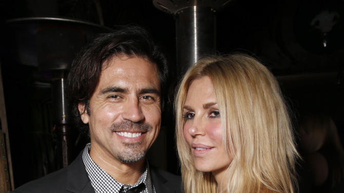 Jonathan Ruiz and Brandi Glanville attend Darin Harvey's 50th Birthday Party at Sur Restaurant, on Saturday March 30, 2013 in Los Angeles.(Photo by Todd Williamson/Invision/AP)