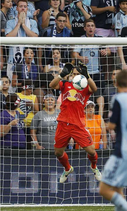 New York Red Bulls goalkeeper Luis Robles (31) makes a save during the first half of an MLS soccer match against Sporting Kansas City in Kansas City, Kan., Saturday, Aug. 3, 2013