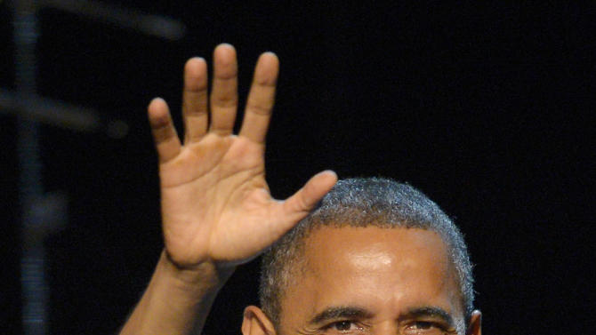 President Barack Obama waves before speaking at a campaign event at the Nokia Theater, Sunday, Oct. 7, 2012, in Los Angeles. (AP Photo/Mark J. Terrill)